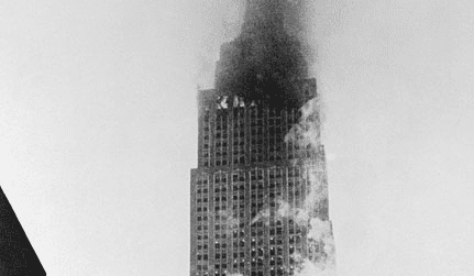 Empire State Building burning after being struck by a B29 bomber, 28 July 1945Source: Argunners Magazine empire-state-building-1945-after-crash.png