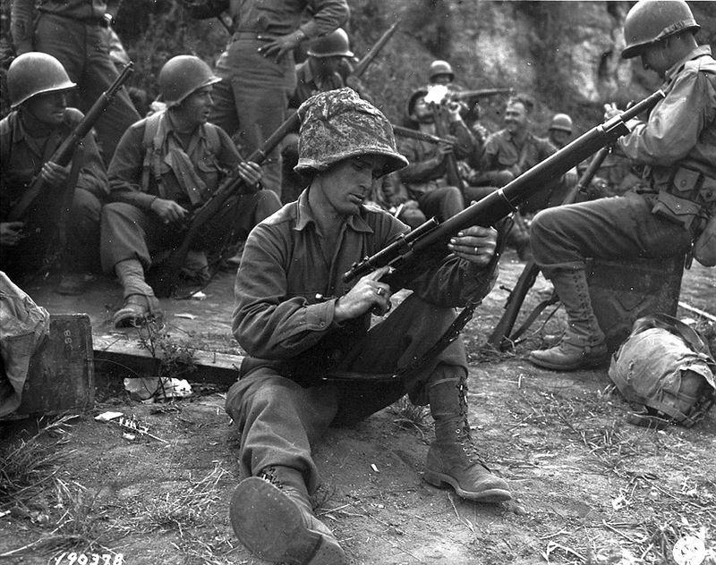 M1 Garand with a scoped bolt action 1903.