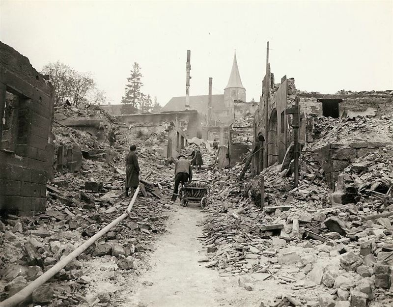 "German civilians in the middle of their town. Gen. Palmer remarked: ""Well liberated town."""