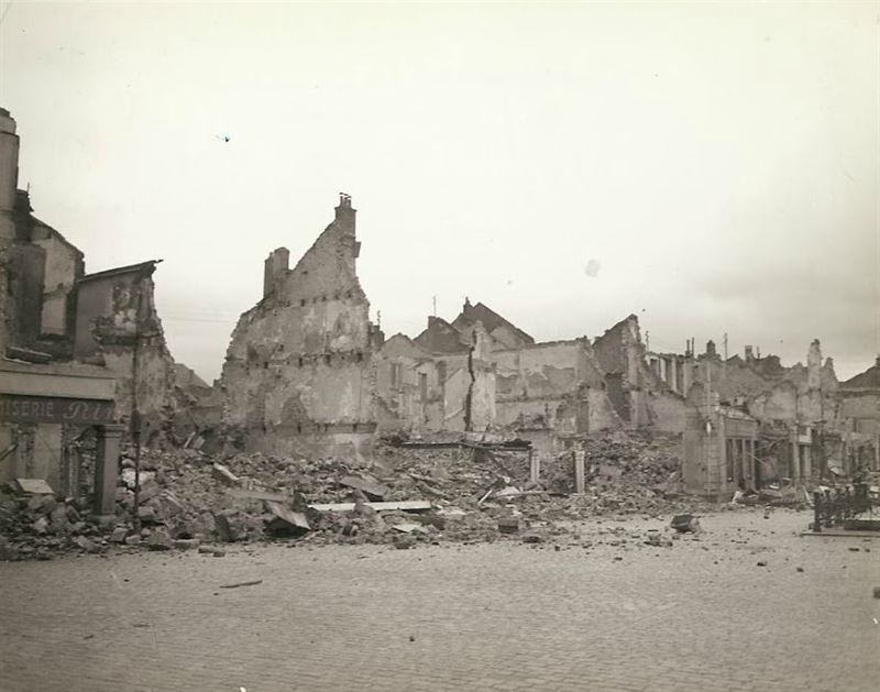 "Wrecked and burned buildings in France. The buildings were mined and burned by the Germans. ""Remains of a friendly little town, that was 'scorched'"", Gen. Palmer wrote on the backside."