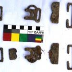 Brass fittings from a Pattern 37 Haversack found with the remains of an Australian soldier who died in West Timor in February 1942. (Credits: Australian Department of Defence)