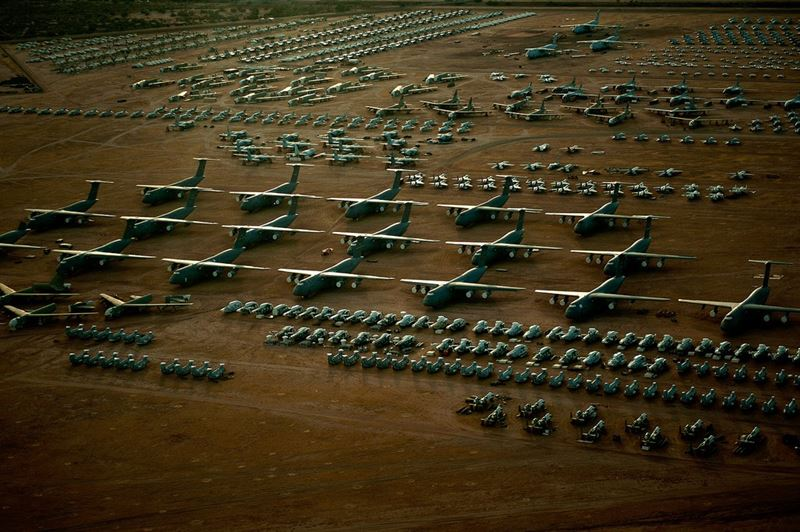 "A fleet of C-5 Galaxies tower above the rest of the fighter and cargo aircraft inside the ""Boneyard"" of the 309th Aerospace Maintenance and Regeneration Group at Davis-Monthan Air Force Base, Ariz. (Credits: U.S. Air Force photo/Tech. Sgt. Bennie J. Davis III)"