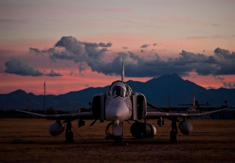 "An F-4 Phantom II at sunset inside the ""Boneyard."" The Phantom has the distinction of being the last U.S. fighter flown to attain ace status in the 20th century. (Credits: U.S. Air Force photo/Tech. Sgt. Bennie J. Davis III)"