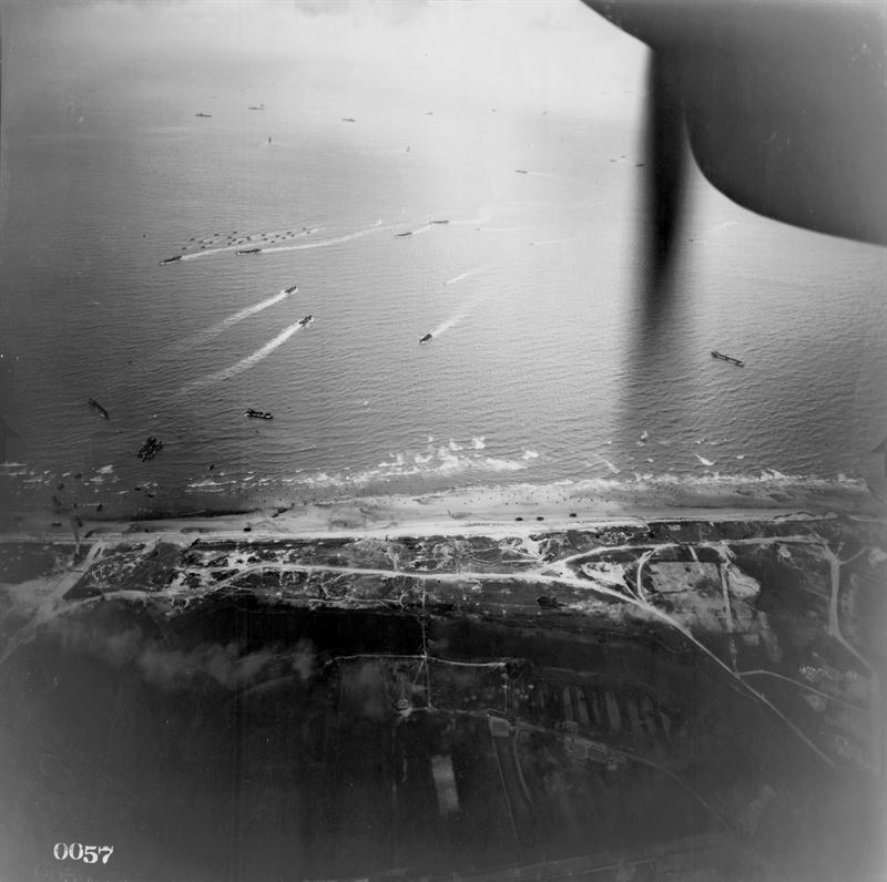 An aerial view of a part of the invasion coast at Normandy, France. Overlooking Juno Beach at Courseulles-sur-Mer. The photo was taken from a U.S. Army Air Forces Lockheed F-5 Lightning reconnaissance plane.