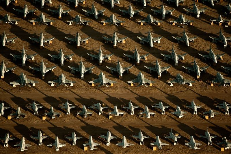 "Rows of F-4 Phantoms and T-38 Talons line the grounds of the 309th Aerospace Maintenance and Regeneration Group, also known as the ""Boneyard,"" at Davis-Monthan Air Force Base, Ariz. (Credits: U.S. Air Force photo/Tech. Sgt. Bennie J. Davis III)"