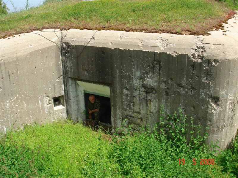 "The ""hidden"" entrance at Arpalouki fortress. Note the bullet holes on the walls, a vivid reminder of the fierce battles that took place exactly here in April 1941"
