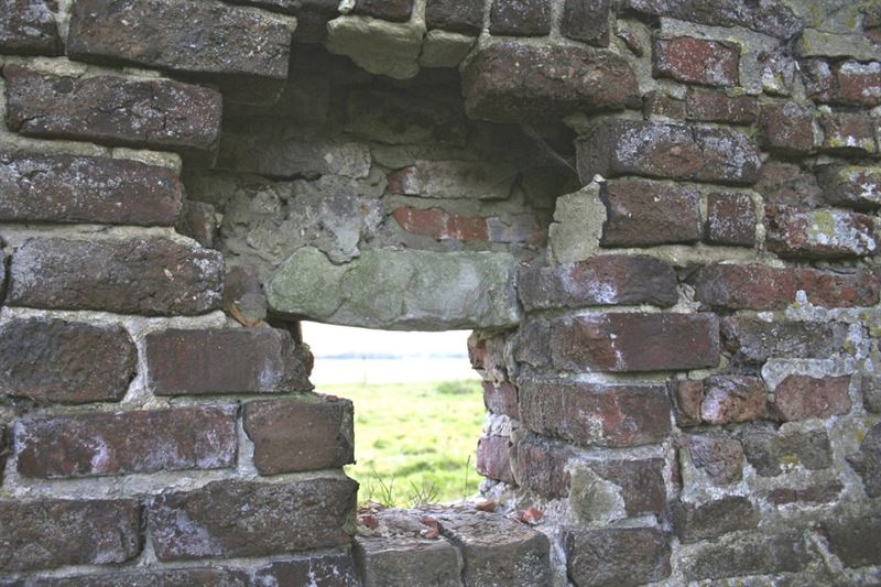 Holes in the Hougoumont chateau wall used to shoot through.