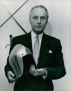 Photo Of Adrian Malcolm Conan Doyle Holding A Knight's Helmet.